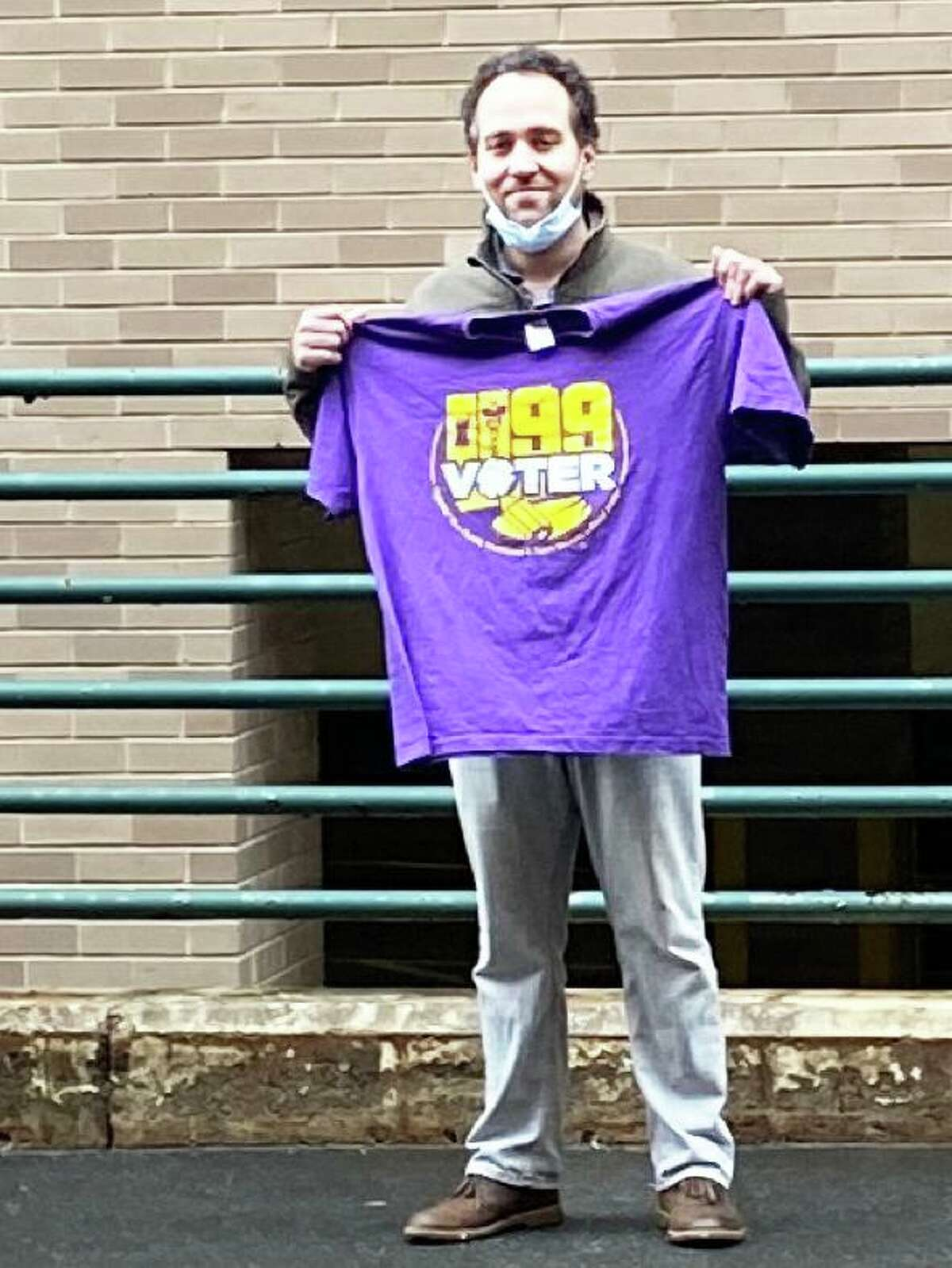 The SEIU Union, representing Department of Mental Health and Addiction Services employees, delivered a 1,100-signature petition to the agency Friday, requesting lifesaving PPEs, expanded safety protocols and essential pay. Here, Julio Reyes shows off his shirt.