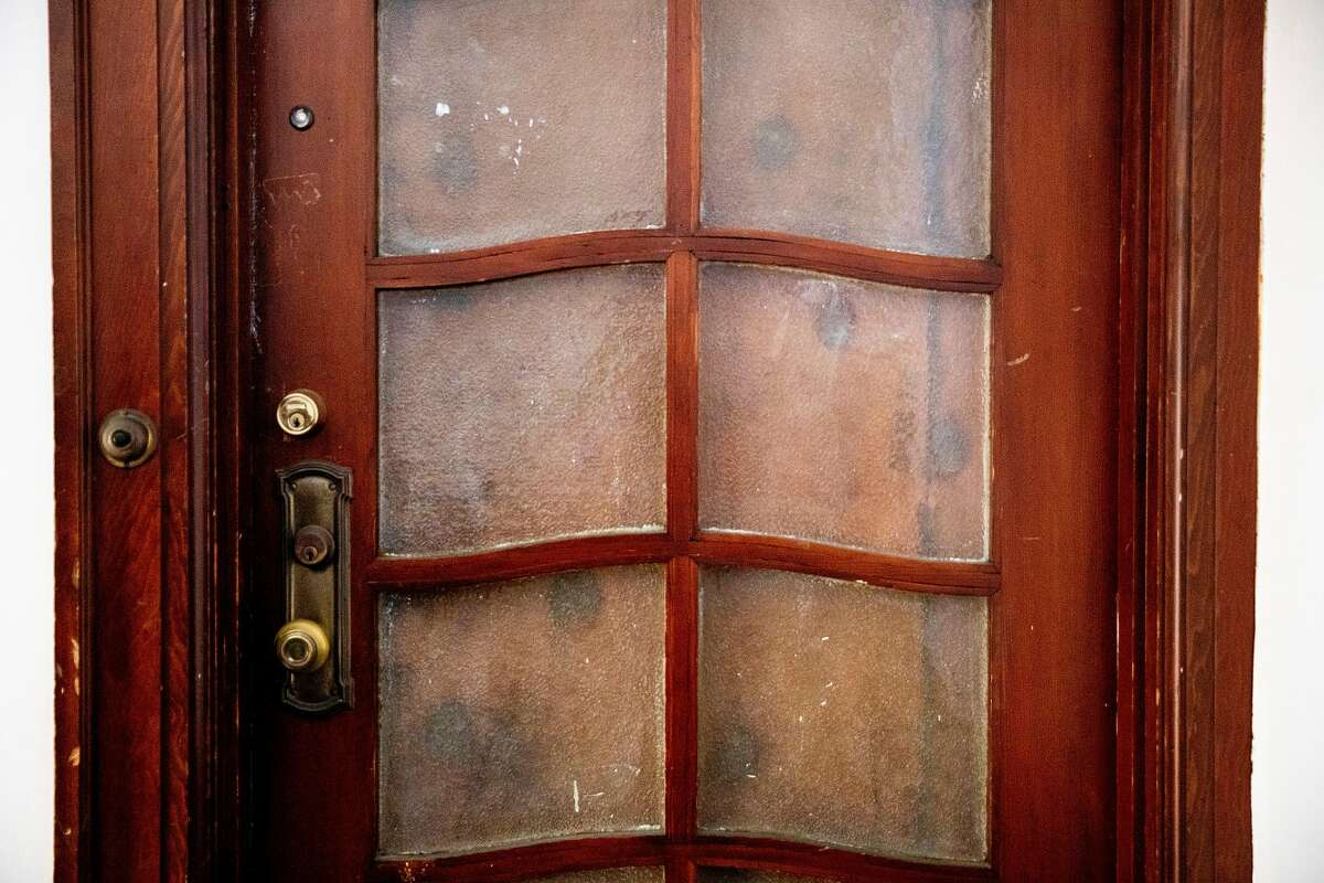 The apartment door of Larry Kaplan is seen in San Francisco, Calif. Friday, April 10, 2020. It's almost certain the number of COVID-19 cases in San Francisco has been underestimated. Neighbors believes Larry Kaplan, a longtime Yellow Taxi driver, had COVID-19. He had been ill for much of February after picking up a raft of travelers from the airport, and complained of weak lungs and a cough that wouldn't go away. He was found dead during a welfare check in March, and the medical examiner's office is investigating.