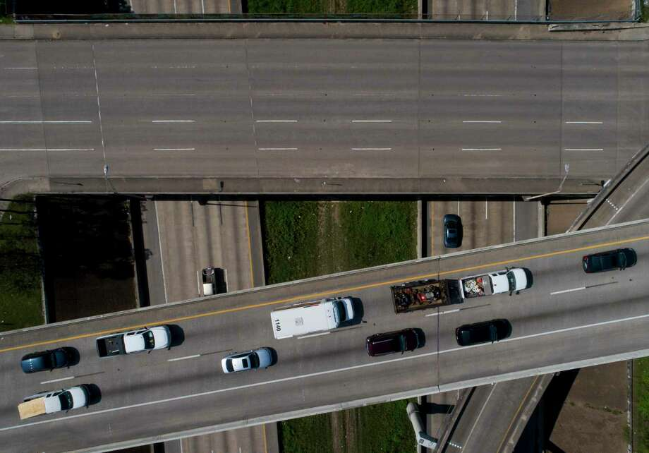 Traffic moves along Interstate 45 near Interstate 69 during the first day of a stay-at-home order put in place by county and city officials on March 25, 2020, in Houston. Photo: Godofredo A. Vásquez, Houston Chronicle / Staff Photographer / © 2020 Houston Chronicle