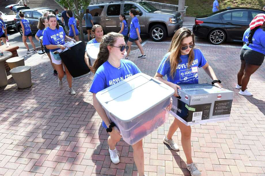 Members of the Move-In Crew assist freshmen moving their belongings into dorm rooms at Quinnipiac University's Irmagarde Tator Hall in Hamden on Aug. 22, 2019. Photo: Arnold Gold / Hearst Connecticut Media / New Haven Register