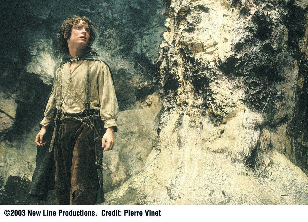 """Description: Elijah Wood """"Frodo"""" makes his way through Minas Morgul in New Line Cinema's epic adventure, The Lord of the Rings: The Return of the King. Download high resolution image Photo Credit: Pierre Vinet/A©2003 New Line Productions"""