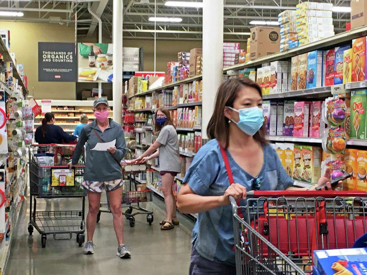 Shoppers at the Sugar Land HEB grocery store on Hwy 6 on Tuesday, April 7, were spotted wearing masks after new recommendations from the Centers for Disease Controll advised wearing a face covering was needed to slow the spread of COVID-19.