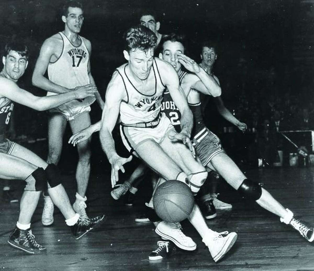 Wyoming's Kenny Sailors dribbles against St. John's on April 1, 1943.