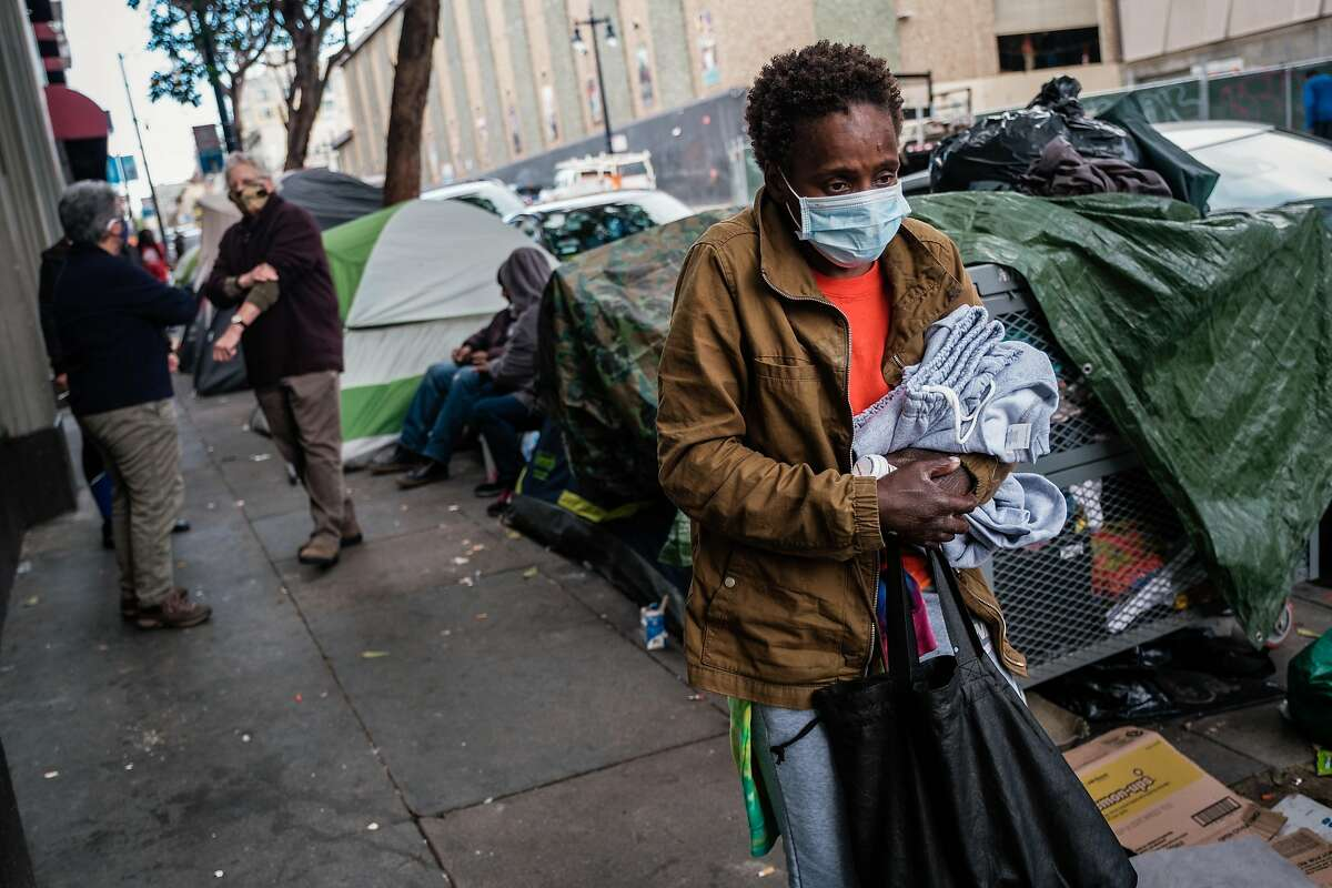 A woman who wished not to be identified and who recently got out of the hospital and is desperate for accommodation puts her belongings in her friend�s tent in the Tenderloin in San Francisco, Calif. on Friday April 10, 2020.