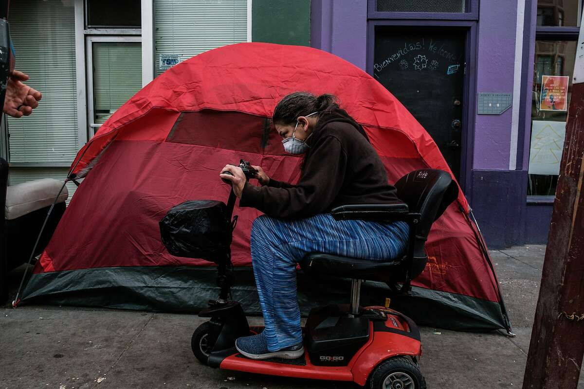 Sidewalks are crowded with people and tents in the Tenderloin in San Francisco, Calif. on Friday April 10, 2020.