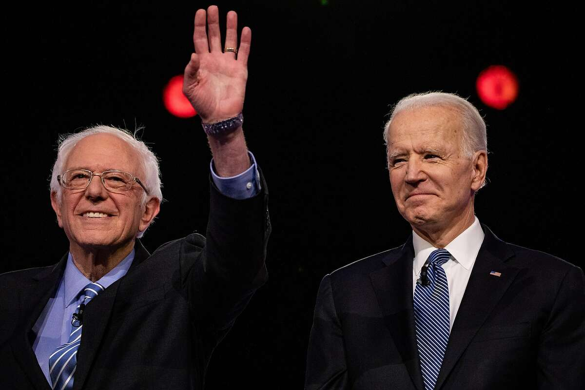 FILE -- Sen. Bernie Sanders and Former Vice President Joe Biden prior to the start of the Democratic presidential debate in Charleston, S.C., Tuesday, Feb. 25, 2020. Sanders withdrew from the race April 8, 2020. (Damon Winter/The New York Times)