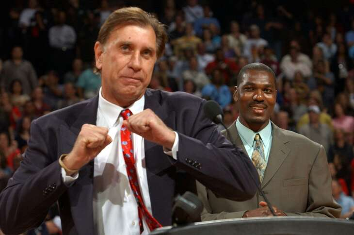 Rudy Tomjanovich, doing his version of the Dream Shake at Hakeem Olajuwon's retirement ceremony in 2002, says he never would have made the Hall of Fame if he didn't have Olajuwon as a player.