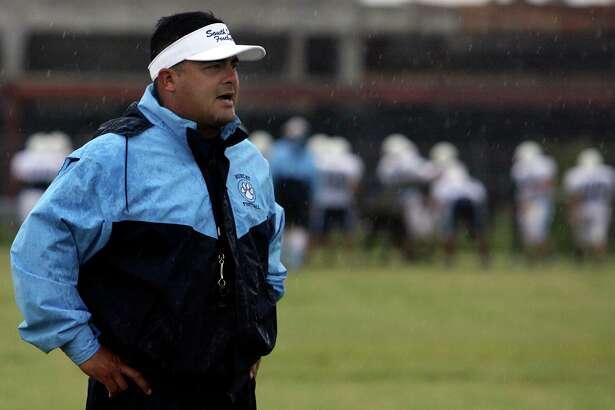 SPORTS: South San football coach John Torres coaches his team in the rain on Thursday August 16, 2007.JOHN DAVENPORT / STAFF