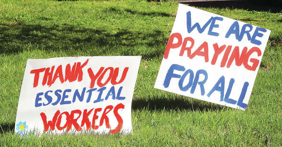 Joining a neighbor who also has signs, a house in the 1000 block of Washington Avenue in Alton shows its support for area first responders who are on the front lines of the COVID-19 pandemic. First responders are often the initial point of contact infected people have with the community. Photo: John Badman | Hearst Newspapers