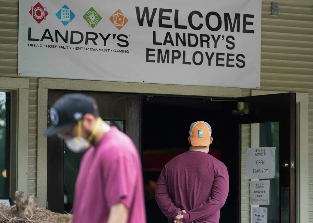 Landry's employees wait to enter to pick up food amid the coronavirus pandemic at the former Willie G's location at 1605 Post Oak Tuesday, April 7, 2020, in Houston. Since March 21, Landry's has been offering free daily meals for its furloughed restaurant employees in the Houston, Galveston, and Kemah areas.