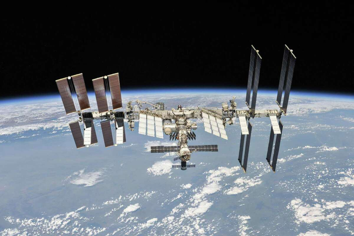 In this image released by NASA/Roscosmos, the International Space Station photographed by Expedition 56 crew members from a Soyuz spacecraft after undocking, on October 4, 2018. A NASA astronaut was accused by her estranged spouse of hacking her bank account from aboard the station.