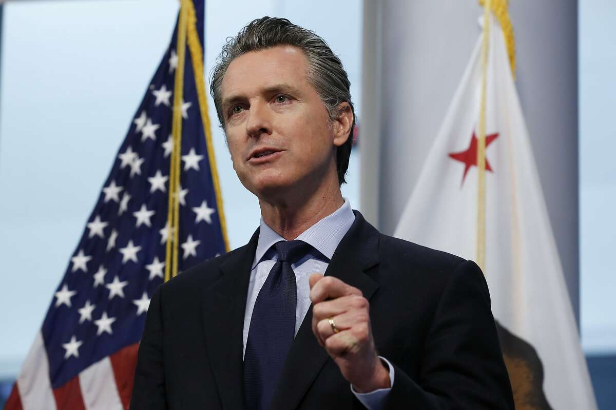 In this photo taken Thursday, April 9, 2020, Gov. Gavin Newsom gives his coronavirus update at the the Governor's Office of Emergency Services in Rancho Cordova, Calif. California public health officials said Friday, April 10, that the spread of the coronavirus in the state might not be as high as expected. Newsom said he was already making detailed plans on how to re-open the state while still stressing the need for people to say at home and stay away from others. (AP Photo/Rich Pedroncelli)