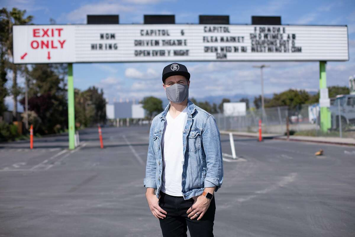 Pastor Micaiah Irmler, of Southridge Church, poses for a portrait in front of the entrance to the Capitol Drive-In Friday, April 10, 2020, in San Jose, Calif. His church is planning to give away masks and food during a drive through service at the drive-in on Easter Sunday. The pastor will give his sermon over the radio.