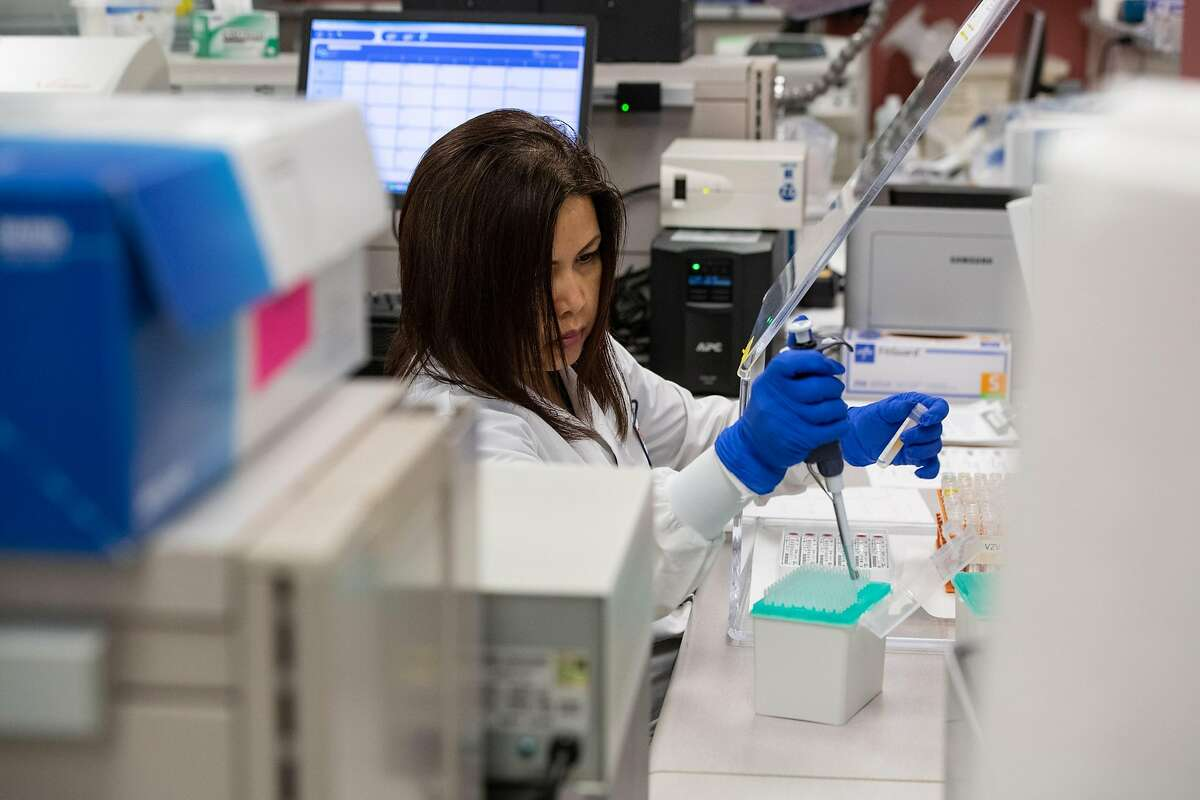 Medical researchers perform serology, testing blood samples to find out whether someone already had and recovered from COVID-19, in Stanford University's Clinical Virology Lab in March�2020.