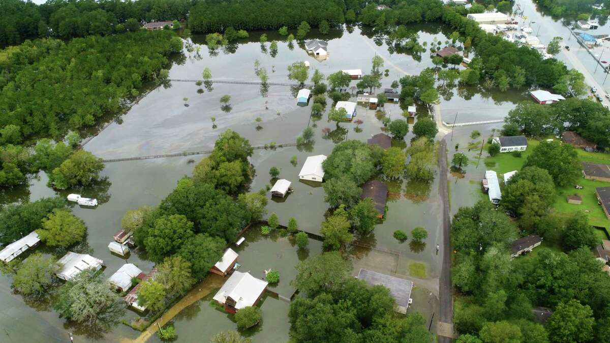 Flood waters from Tropical Storm Imelda surround Fannett homes near Texas 124 on Friday. Photo taken Friday, 9/20/19