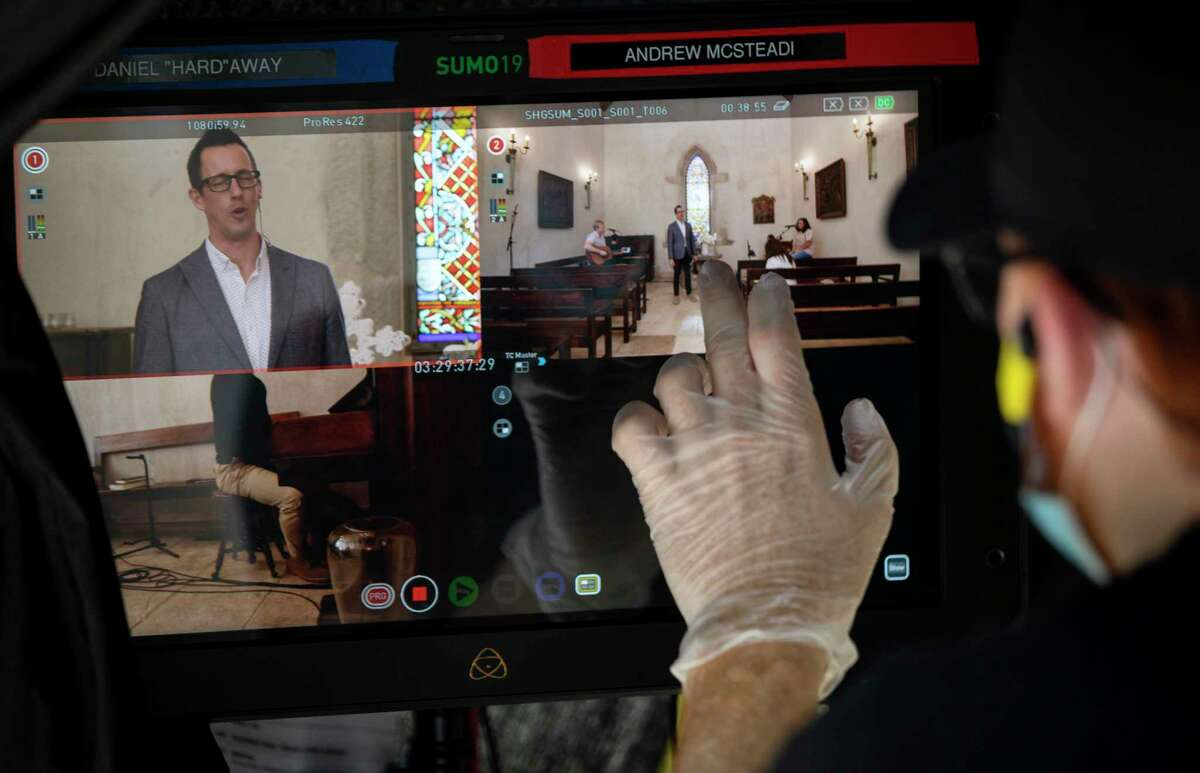Andrew McMillan, a freelance film director, works to produce an Easter service for The Story Houston, a church, Thursday, April 9, 2020, at a private chapel in Houston. The church decided to stream the service in order to abide by social distancing guidelines, because of the COVID-19 pandemic. The Havens Chapel was originally built in 1790 in central France. A Houston couple purchased it in 2006 and had it disassembled and shipped to Texas. The chapel has survived the French Revolution, epidemics, plagues, the Spanish Flu and two world wars.