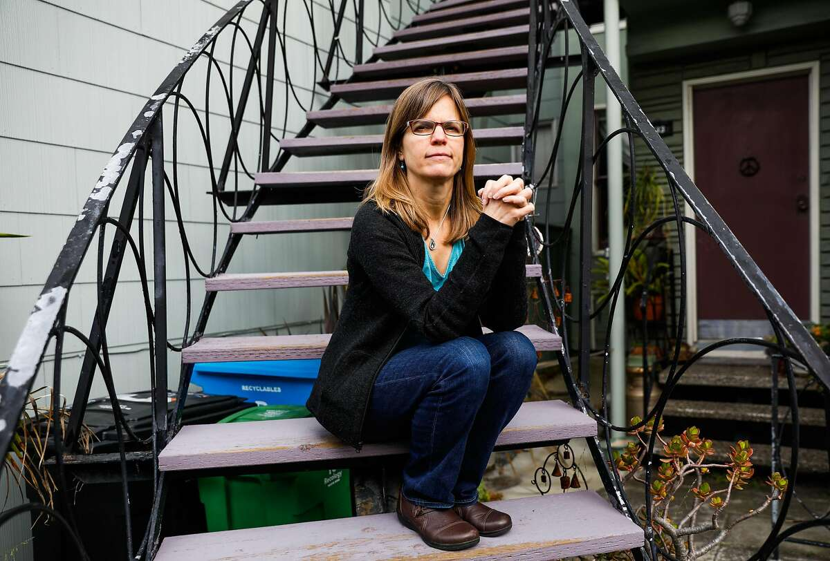Elizabeth Brooks, the daughter of palliative care patient Robert Lewis poses for a photograph outside her home on Thursday, April 9, 2020 in San Francisco, California.