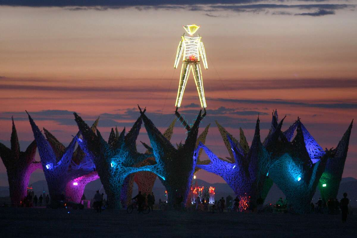 The Burning Man art structure looms over the playa just before sunrise over at Burning Man festival at Black Rock, NV., on September 3, 2009.
