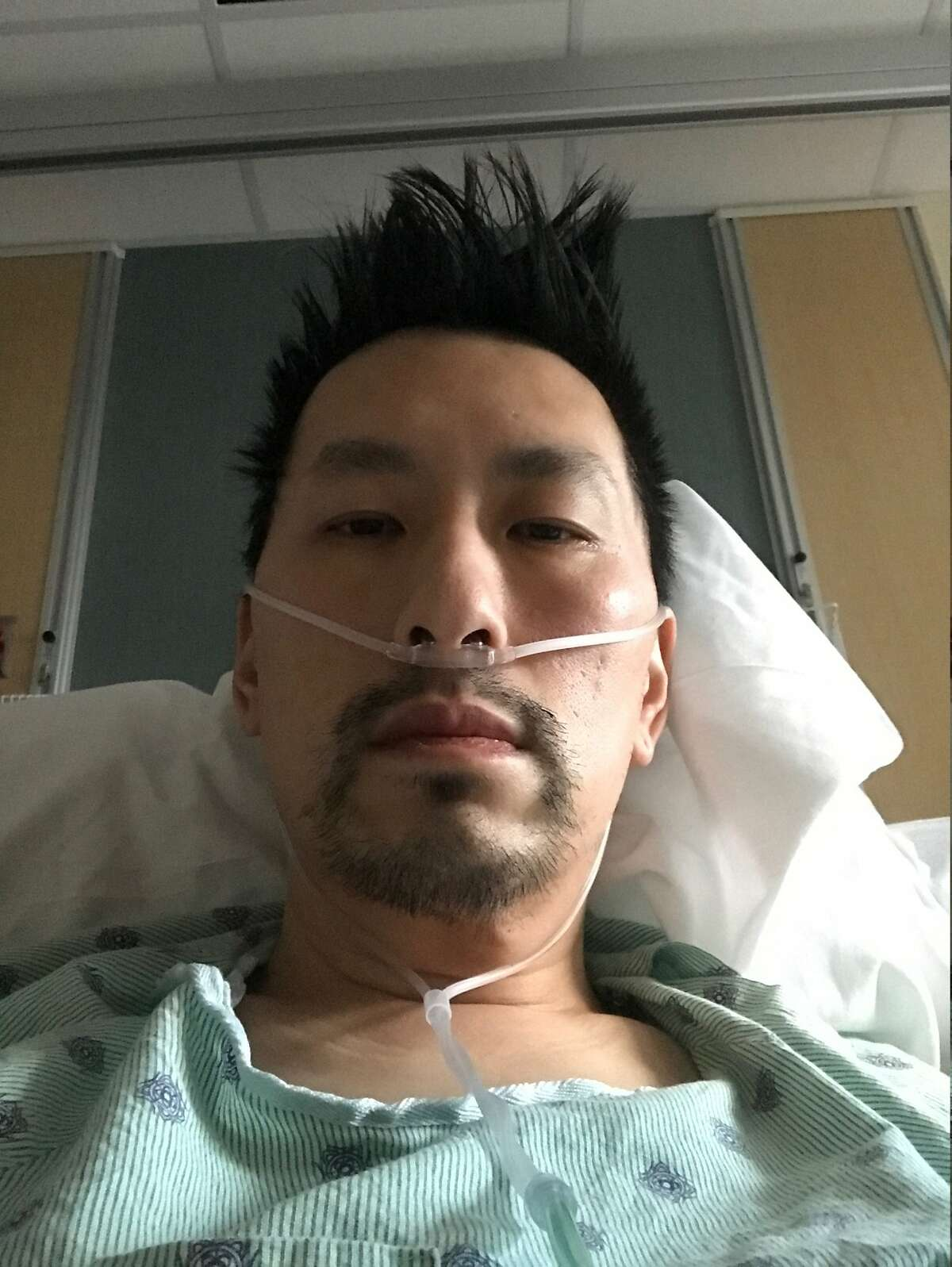 Ken Loo from his hospital bed on March 17, a few days after he was hospitalized for COVID-19.