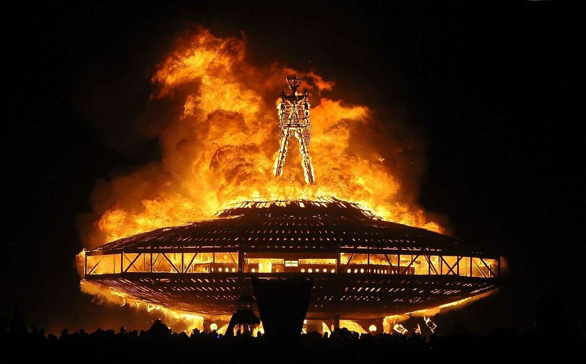 """FILE - In this Aug. 31, 2013 file photo, the """"Man"""" burns on the Black Rock Desert at Burning Man near Gerlach, Nev. Burning Man organizers sued the U.S. Bureau of Land Management to recover millions of dollars they say the government has overcharged them in fees over the past seven years at the counter-culture celebration in the Nevada desert. Black Rock City LLC, the nonprofit that produces the annual Burning Man event, filed the lawsuit Dec. 13, 2019 in U.S. District Court in Washington. (Andy Barron/The Reno Gazette-Journal via AP, File)"""
