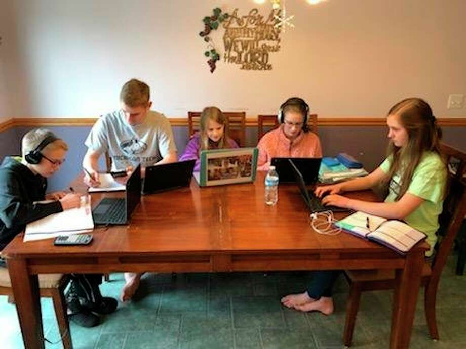 The Bright family'skids are all now at home distance learning with the devices that have been supplied by Calvary Baptist Academy. From left areMicah (7th), Nathan (12th), Kylie (3rd), Callie (10th), Kelsey (9th). (Photo provided)