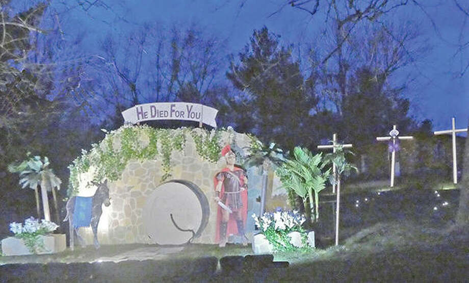 An outdoor display reminds those traveling Merritt Road of the Lenten season, which commemorates the events leading to the crucifixion of Jesus Christ. On Sunday, which is Easter, the display's tomb will be open and show the resurrected Christ. Photo: Melvin Thies | Reader Photo