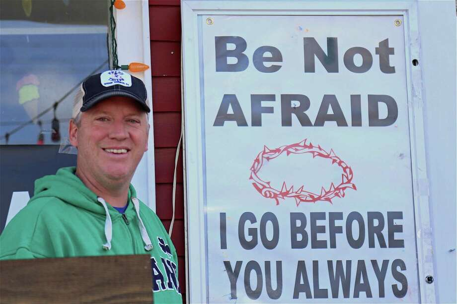 Ken McCabe of Fairfield stands by an Easter message outside of Saugatuck Sweets on Friday, April 10, 2020, in Fairfield, Conn. Photo: Jarret Liotta / Jarret Liotta / ©Jarret Liotta 2020