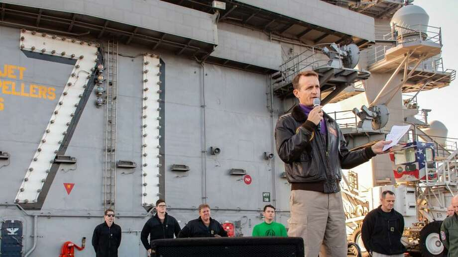Capt. Brett Crozier, then-commanding officer of the aircraft carrier USS Theodore Roosevelt, gives remarks during an all-hands call on the ship's flight deck Dec. 15, 2019. Photo: Seamen Alexander Williams /U.S. N /TNS / U.S. Navy