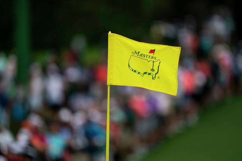 FILE - A 2019 Masters Tournament golf pin flag flies in Augusta, Ga., April 14. The 2020 Masters, golfA?•s first major championship and a signature, springtime event in American sports, was postponed Friday, March 13, by the Augusta National Golf Club, because of the coronavirus pandemic that has led to sweeping changes across the world. (Doug Mills/The New York Times)