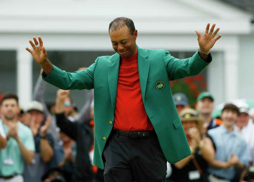 FILE - In this April 14, 2019, file photo, Tiger Woods smiles as he wears his green jacket after winning the Masters golf tournament in Augusta, Ga. (AP Photo/Matt Slocum, File)