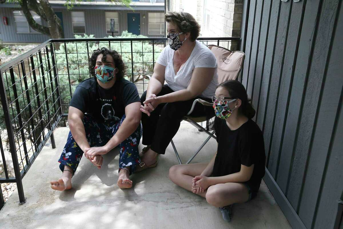 Melissa Harnish and her children get a little fresh air on their apartment balcony.