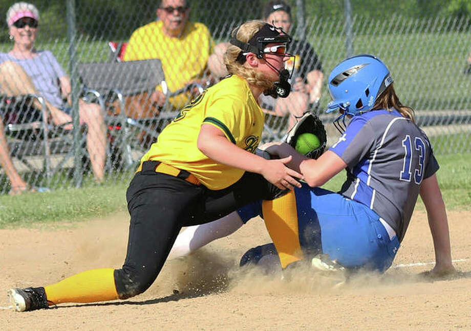 Southwestern third baseman Bri Roloff (left) tags out Marquette Catholic baserunner Allene Brass during a Class 2A regional championship game last season in Piasa. Roloff, who batted .453 with eight home runs 30 RBI, is among a long list of returning starters from a Piasa Birds team that finished 24-3 in 2019. Photo: Greg Shashack / The Telegraph