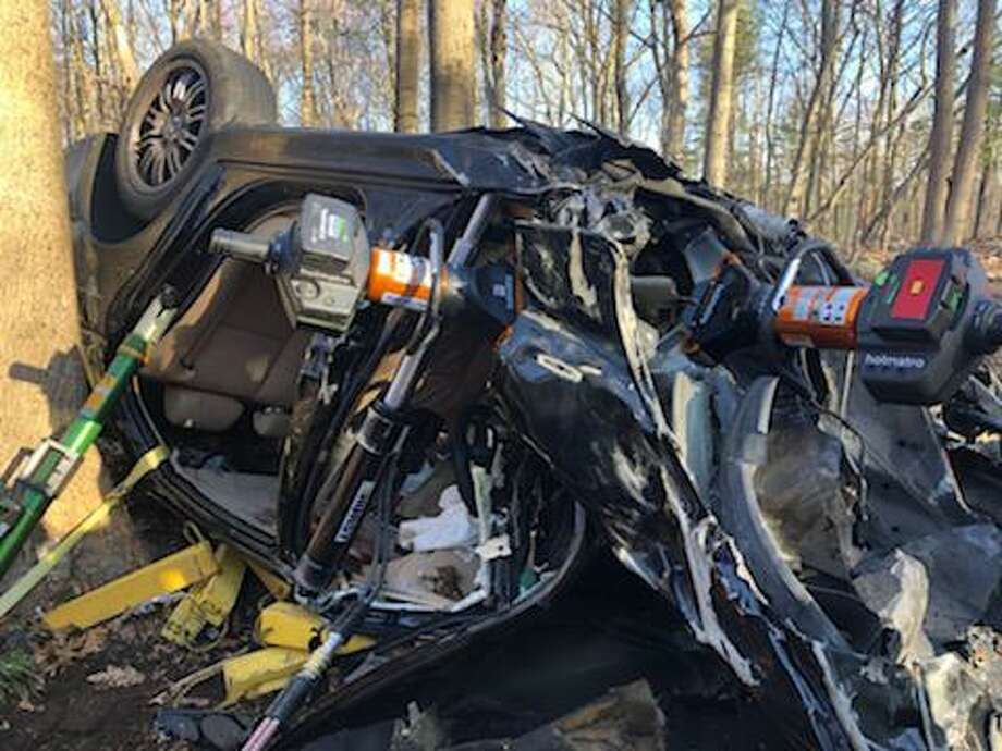 Shelton fire crews responded to a one-vehicle accident on Isinglass Road Saturday, April 11, that left one person serious injured. Photo: Shelton Fire Department / Contributed Photo / Connecticut Post