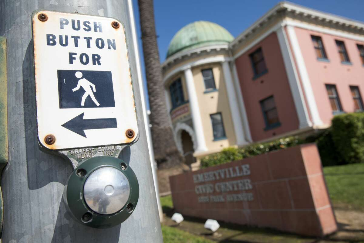 No longer any need to touch pedestrian push buttons in Emeryville. The city will automatically activate pedestrian signs when the traffic light changes.