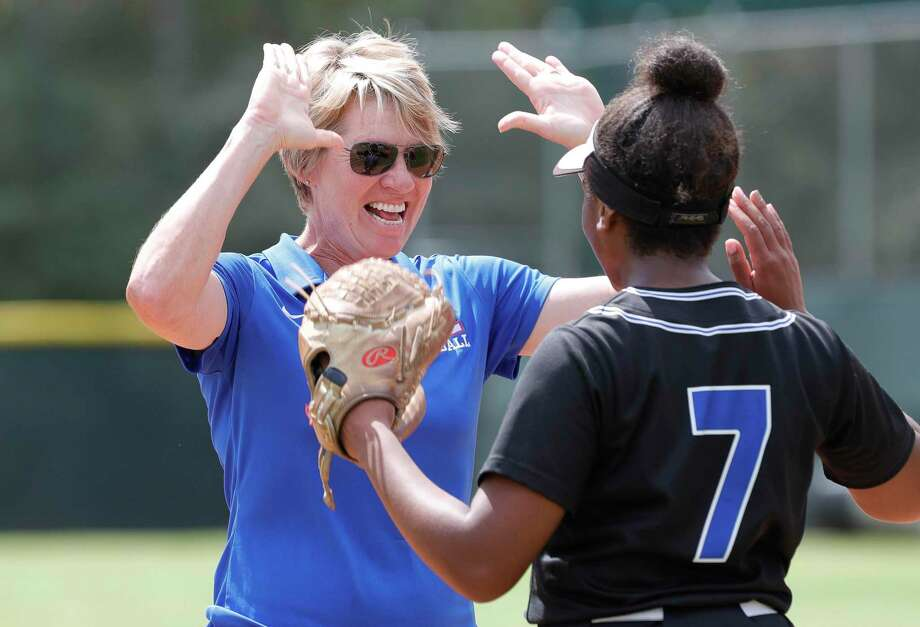 Oak Ridge head coach Stephani Rougeau, left, gives starting pitcher Morgan Brandon a high-five before the first inning of a District 15-6A high school softball game at College Park High School, Wednesday, March 11, 2020, in The Woodlands. Photo: Jason Fochtman, Houston Chronicle / Staff Photographer / Houston Chronicle  © 2020