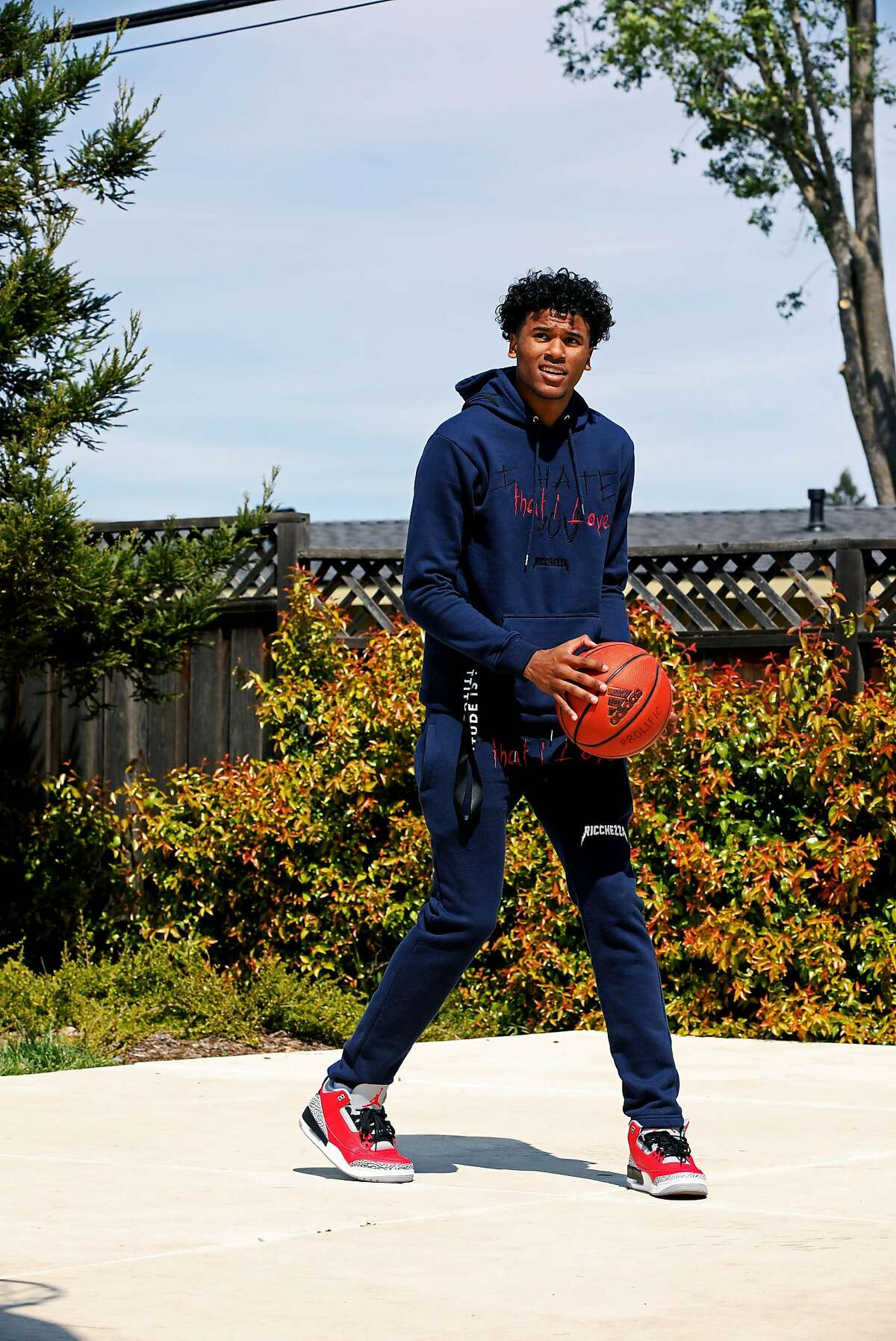 High School basketball star Jalen Green, 18, shoots a basket in his neighborhood on Friday, March 27, 2020, in Napa, Calif. The 6'6
