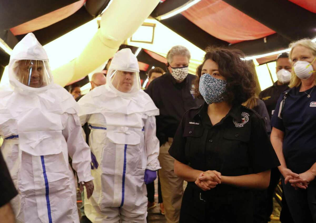 Harris County Judge Lina Hidalgo, right, tours a medical facility that was set up to handle a possible overflow of COVID-19 patients from local hospitals, Saturday, April 11, 2020, at NRG Park in Houston.