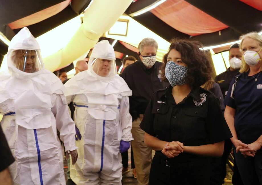 Harris County Judge Lina Hidalgo, right, tours a medical facility that was set up to handle a possible overflow of COVID-19 patients from local hospitals, Saturday, April 11, 2020, at NRG Park in Houston. Photo: Jon Shapley, Staff Photographer / Staff Photographer / © 2020 Houston Chronicle