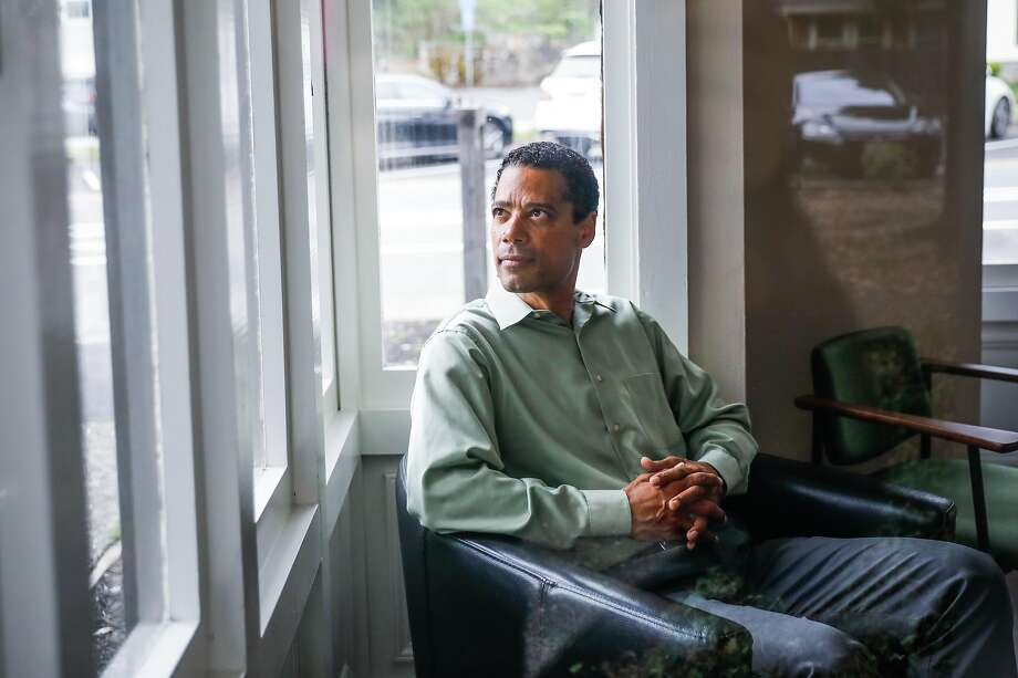 "Dr. Curtis Robinson, president of the Marin County Board of Education, sits in his office in Mill Valley. He says of income inequality amid the pandemic: ""You can determine your COVID-19 fate by the ZIP code you live in."" Photo: Gabrielle Lurie / The Chronicle"