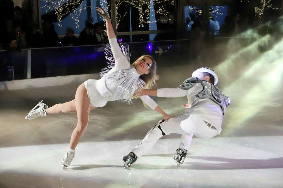 """Melissa Gregory and Denis Petukhov, of Hartford, will be among the Olympic and World Champion figure skaters in the """"Blades for the Brave"""" fundraiser Friday, April 17, to aid health workers fighting the pandemic. The event will be livestreamed at 8 p.m. to support Americares' COVID-19 response. The couple is seen here skating at The Rink at Brookfield Place in Manhattan this past December. Photo: Melissa Gregory / Contributed Photo"""