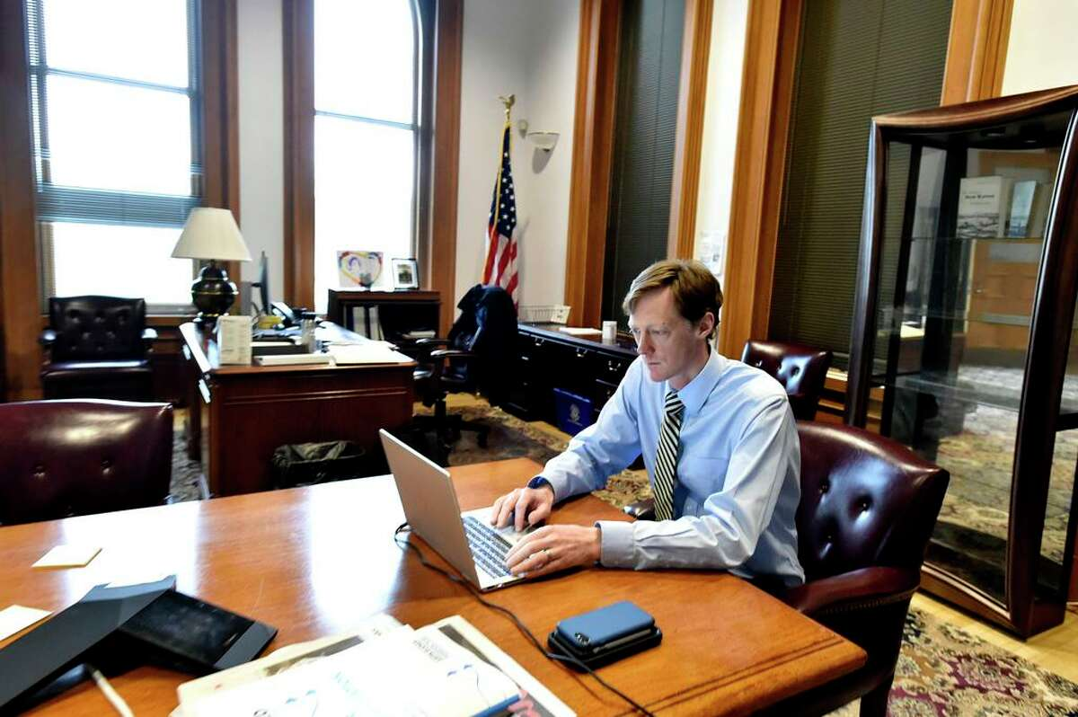 New Haven, Connecticut - Thursday, April 09, 2020: New Haven Mayor Justin Elicker chooses to work at the conference table in his office at New Haven City Hall.