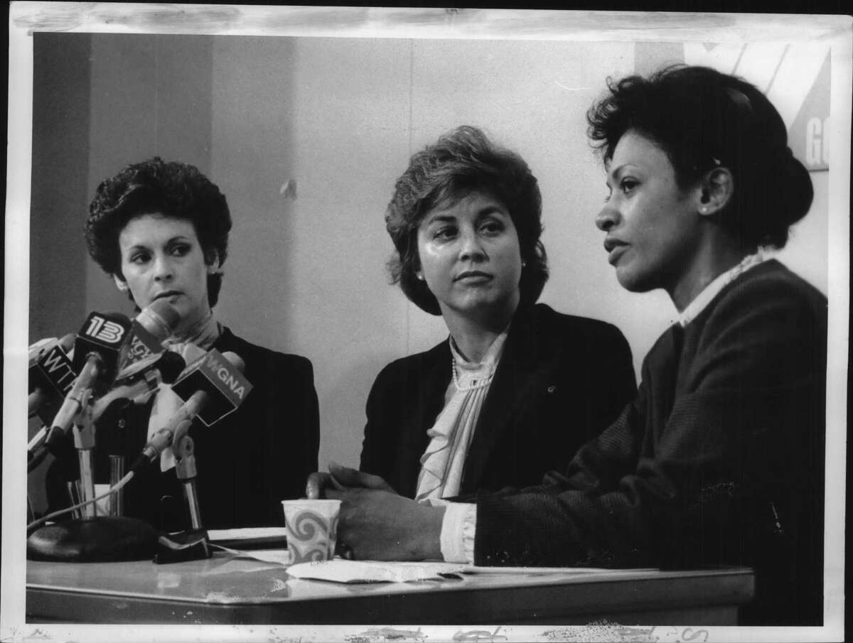 Legislative Correspondents Association press room, Legislative Office Building, Albany, New York - Center for Women in Government - Dr. Dolores E. Cross, Albany, President of the Higher Education Service Corp; Ms. Gail S. Shaffer, Blenheim, Secretary of State; Ms. Nancy D. Perlman, Albany, Executive Director and Founder of the Center. April 12, 1984 (Bob Richey/Times Union Archive)