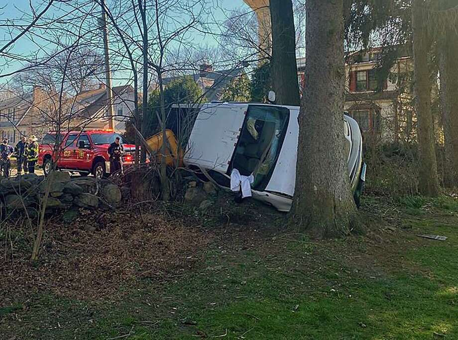A driver collided with a tree after crashing into a building in Norwalk, Conn., on Saturday, April 11, 2020. Photo: Contributed Photo / Norwalk Police Department