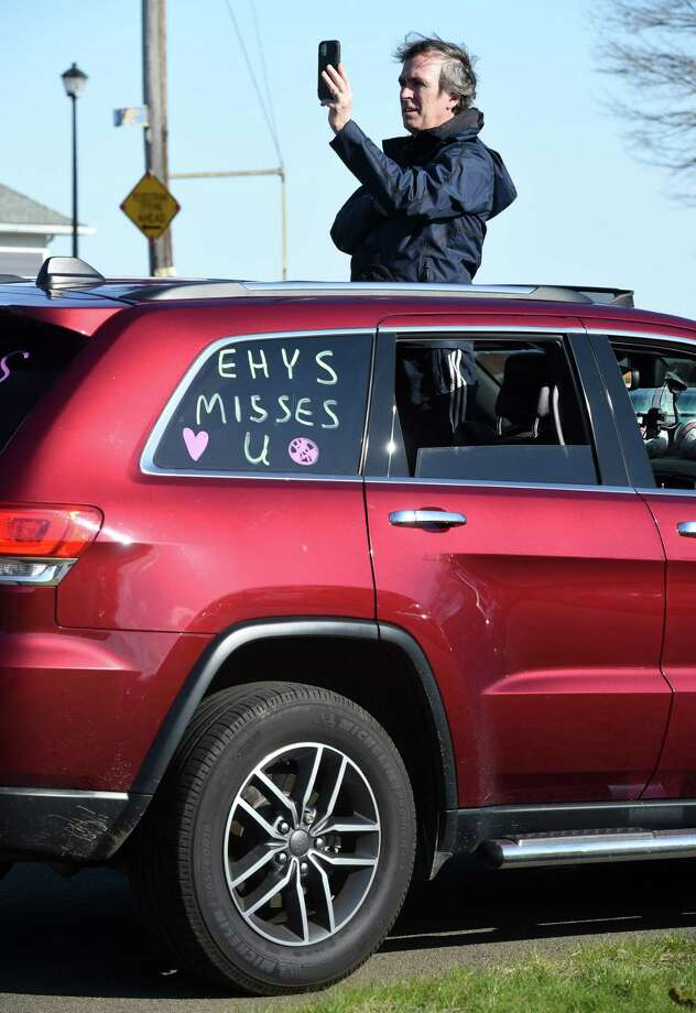 """Cars line up for the """"East Haven Proud"""" Motorcade on Coe Avenue in East Haven on April 11, 2020.  The motorcade traveled through East Haven ending at East Haven High School. Photo: Arnold Gold, Hearst Connecticut Media / New Haven Register"""