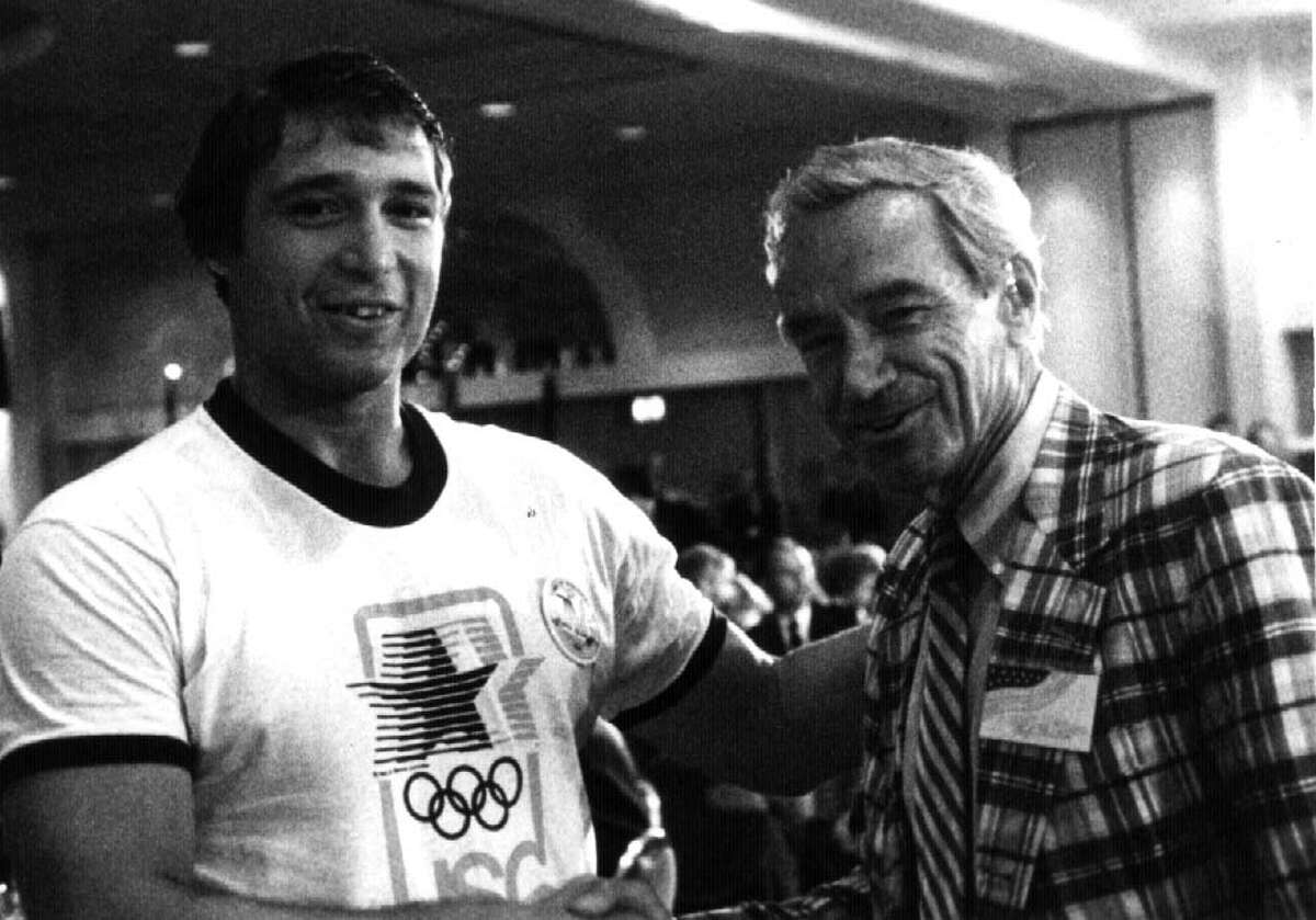 Gold medal winner Jeff Blatnick of Niskayuna talks with congressman Sam Stratton (D-Schenectady). (Times Union archive)