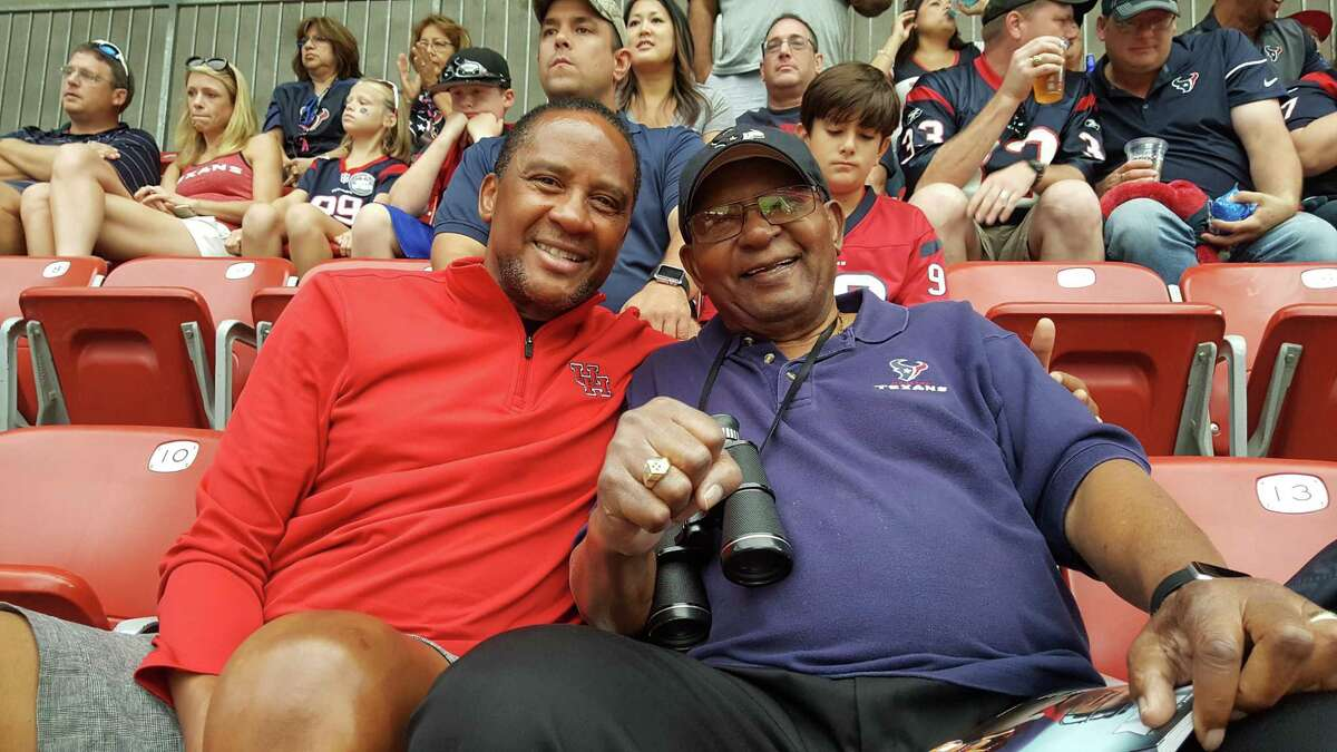 James C. Campbell with son James T. Campbell at a 2018 Texans game.