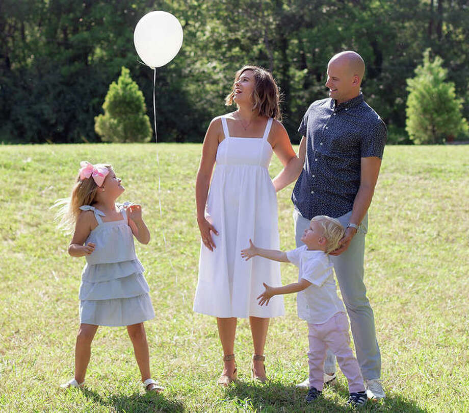 The Battas family — (from left) Beckett, mom Ashley, Brooks and dad Dustin — let a balloon fly into the air in memory of Ben, who passed away on April 4, 2019, after a stillbirth. Photo: Submitted Photo