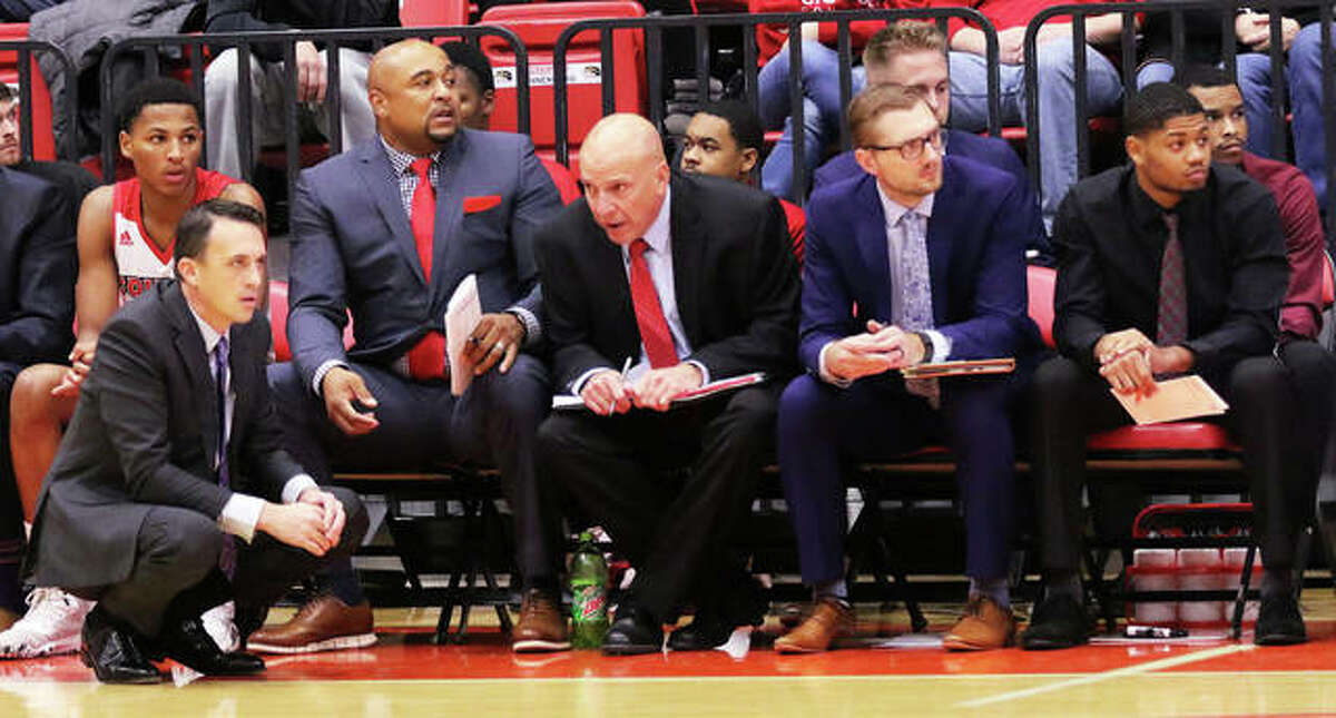 SIUE coach Brian Barone watches his team against Valpo in front of the bench with (from left) assistant Bubba Wells, assistant Mike Waldo, director of operations Colin Schneider and graduate assistant for player development D'tae McMurray.