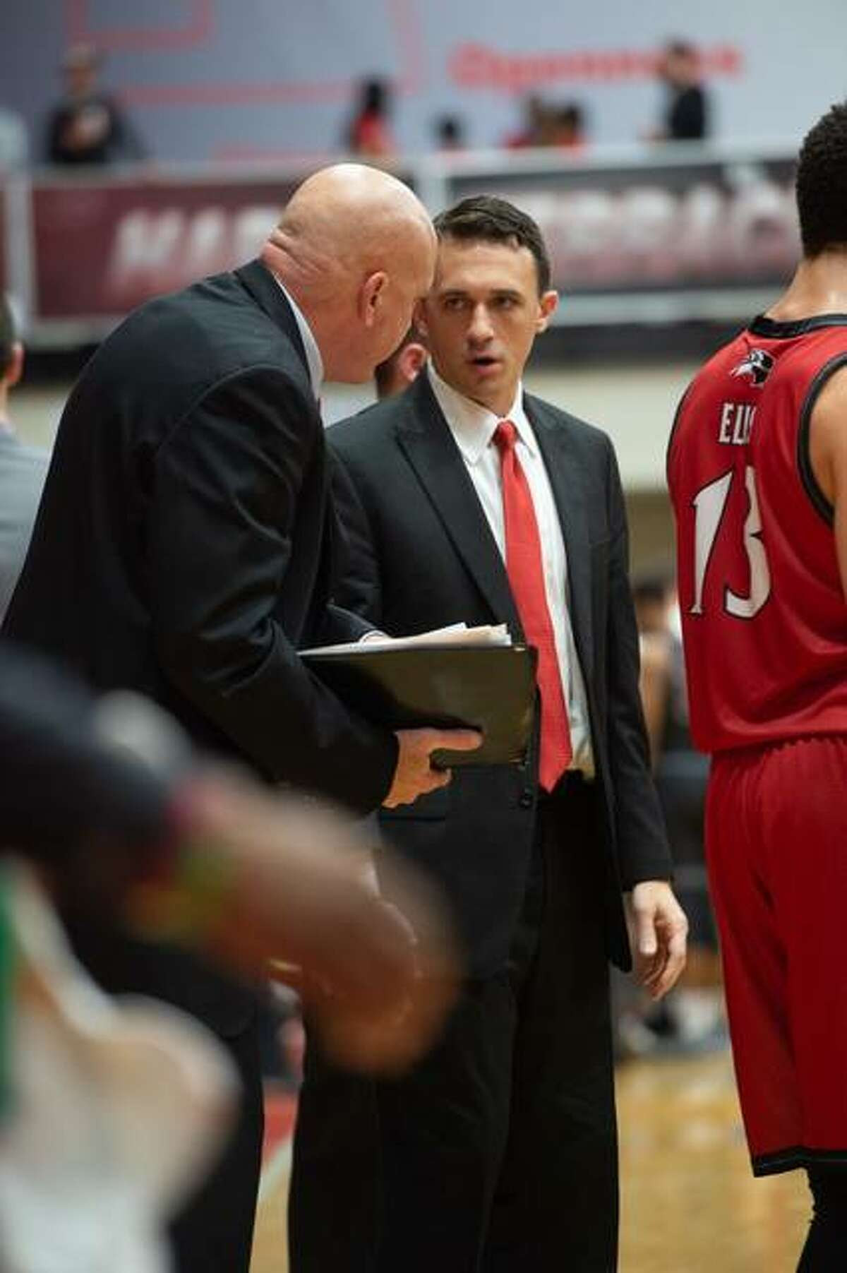 Brian Barone talks to assistant coach Mike Waldo during a game.