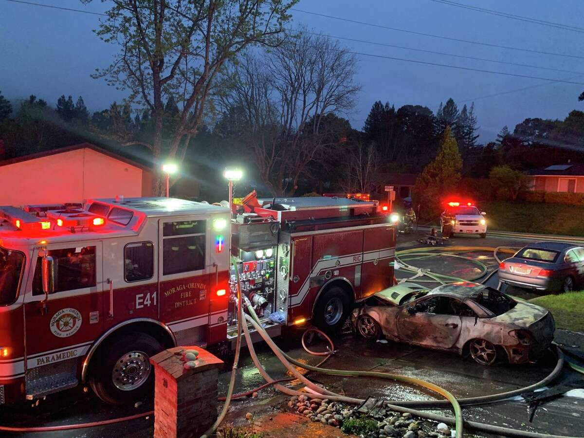 A burning car rolled into a fire engine in Orinda early Sunday morning while firefighters battled a house fire.